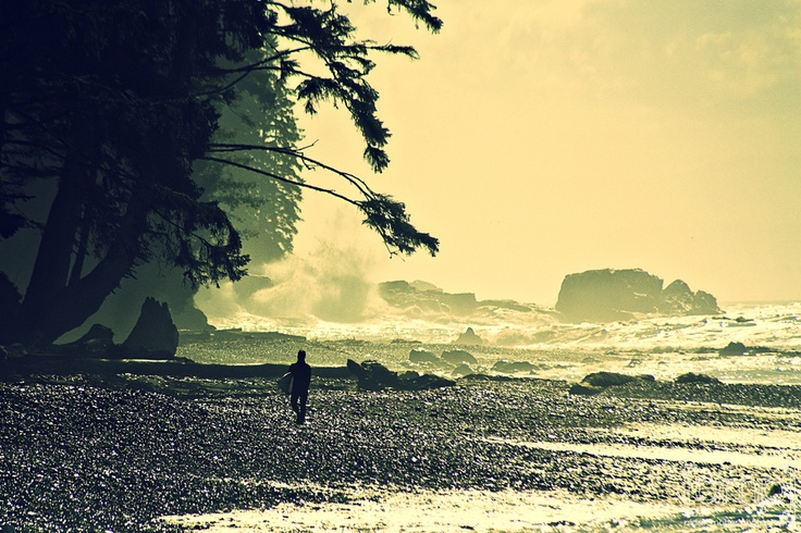 Surfing at Sombrio Beach on Vancouver Island, BC, Canada.