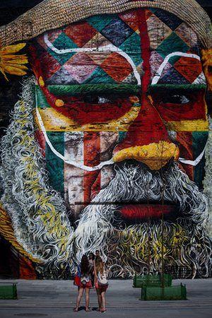 Rio de Janeiro, BrazilPeople take photos in front of Etnias, a large mural by local graffiti artist Eduardo Kobra at Porto Maravilha