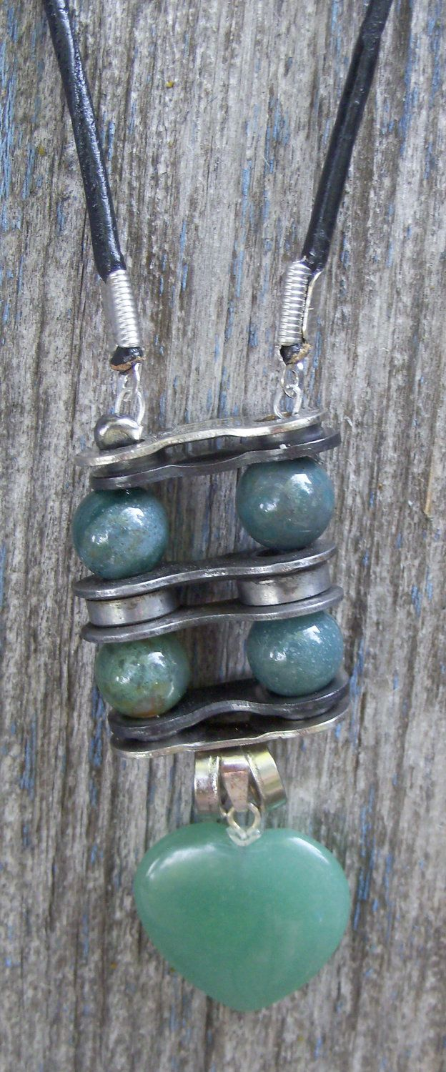 I'm thinking bike chains could make good spacers in necklaces/bracelets, too.  --Green Aventurine Gemstone Necklace with Recycled Bike Part Pendant. $25.00, via Etsy.