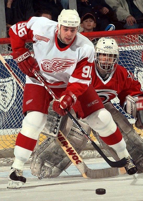 Tomas Holmstrom doing what he did best - making life miserable for opposing goaltenders.  #96.