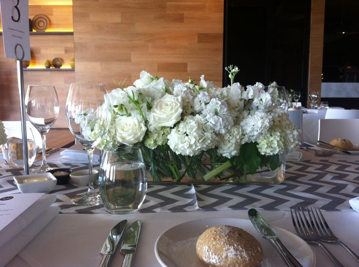 Tank vases at Encore, St Kilda. |by Flower Jar. | Chevron runners by Table Art.