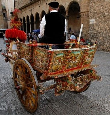 Painted Sicilian Carts ~ are covered in brightly painted scenes from Sicilian folklore or history. At a time when most of the island`s residents were illiterate, the carts were able to illustrate not only historical events but also provide information on the owners and their trade. The horses and donkeys used to pull the carts are also often dressed up in colorful and elaborate costumes. #Sicily #Painted_Carts #Caretto