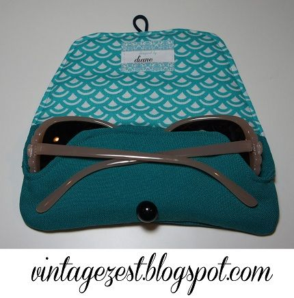 Diane from Diane's Vintage Zest shares a free pattern for making a sunglass case. It opens down the long side, with a simple elastic loop and button closure.