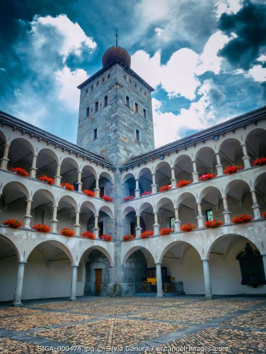 Stockalperschloss court in Switzerland. Castle court with covered walk and tower. - ©Silvia Ganora Photography - All Rights Reserved  #bookcovers #architecture