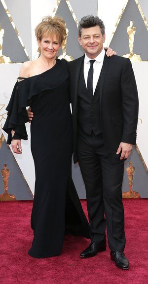 """Lorraine Ashbourne and Andy Serkis. It's Gollum and his actor wife Lorraine. Or """"Landy"""" as no one calls them. Her hair is a bit post-10k run and her louche bare shoulder suggests that she's feeling ready for that free champagne. Fashion approval rating is high for this kind of participatory attitude."""