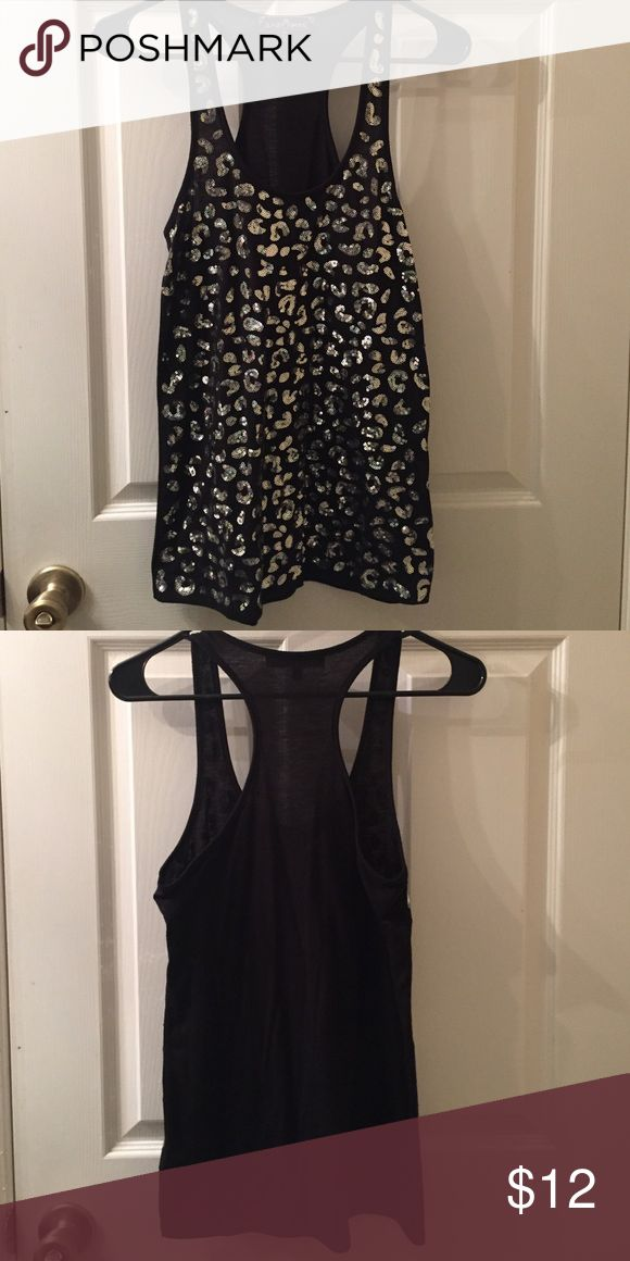 Almost famous black tank top. Black tank top with sequined cheetah print!! In great condition. Only worn a couple of times. Almost Famous Tops Tank Tops