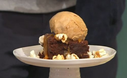 Simon Rimmer served up salted popcorn brownies with ice cream on today's episode of Sunday Brunch. The ingredients include: chocolate, coco powder, bicarbonate soda, salt, flour, popcorn, eggs, brown sugar, caster sugar, vanilla pods and melted butter.     See more recipes from Simon Rimmer in the book titled: Something for the Weekend: 60 fabulous recipes for a Lazy Brunch, available from Amazon now.   Related PostsSimon Rimmer bread and butter pudding with Earl Grey tea recipe on Eat th...