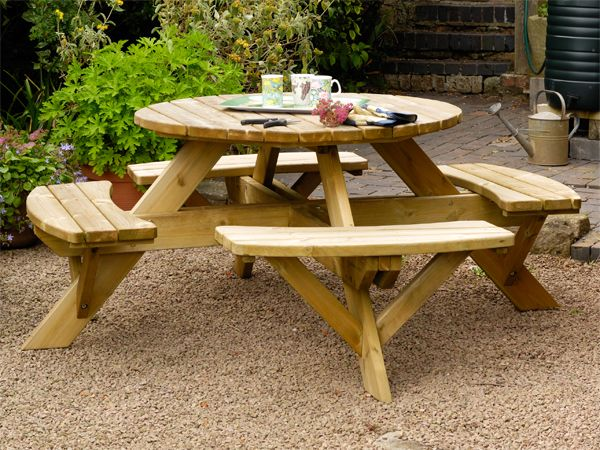 This round picnic table seats up to 8 people comfortably on its 4 benches. A great way to create working or eating spaces outdoors.