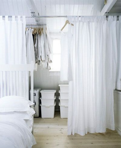 curtains to hide a closet...so doing this; and maybe a mirror and bench in the middle?