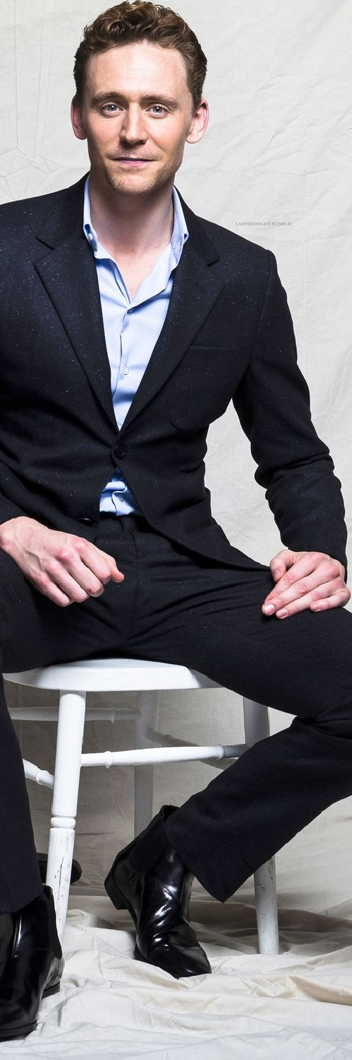 Tom Hiddleston sitting as only Tom Hiddleston can, and still look like a gentleman.