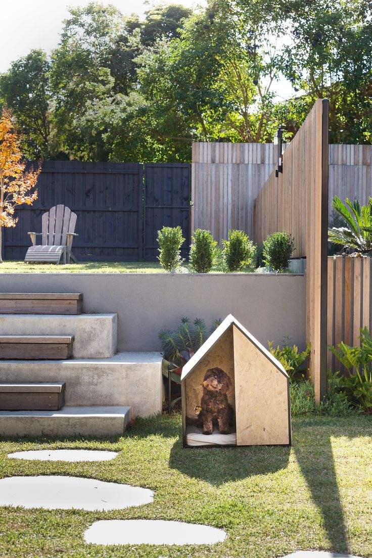Timber and concrete steps lead to a raised lawn area at this energy efficient Melbourne home. The garden includes herb and vegetable beds and a swimming pool. Photography: Martina Gemmola | Styling: Ruth Welsby