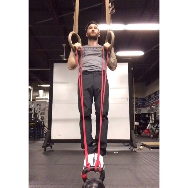 FALSE GRIP STRENGTH & STRETCH Building the false grip is essential for the strict muscle up. When developed properly, you should be able to hang comfortably with locked out elbows in a false. If you can't do it with elbows locked out clean, you need to work on it. Tight/weak wrists are very common. This drill incorporates a stretch with the false grip hold. Holding the bands put the correct part of the wrist in contact with the ring/bar while stretching them into position. Part of