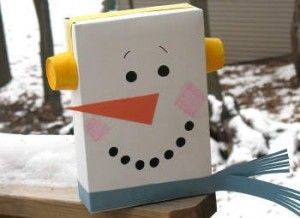 Oh, Millie! If we start saving some boxes, you could make village of snow people!  Millie this snowman is made from a cereal box!  I think you would make some terrific snow people.  A family of snow people, Mom, Dad, Millie, and a little baby box for you know who! :) :) :) I love the idea, Millie.  You're going to be very busy in December!
