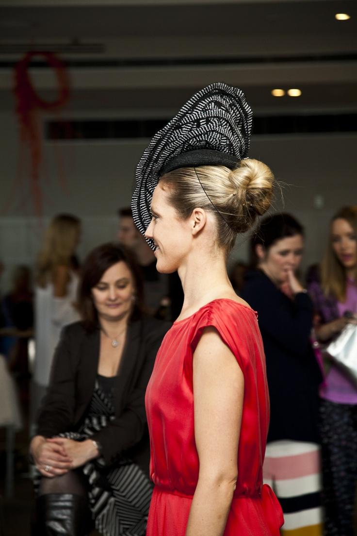 Ange wearing a Serena Lindeman headpiece.