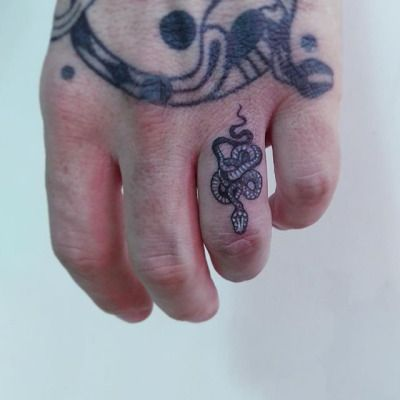 little coiled snake tattoo on a ring finger :)