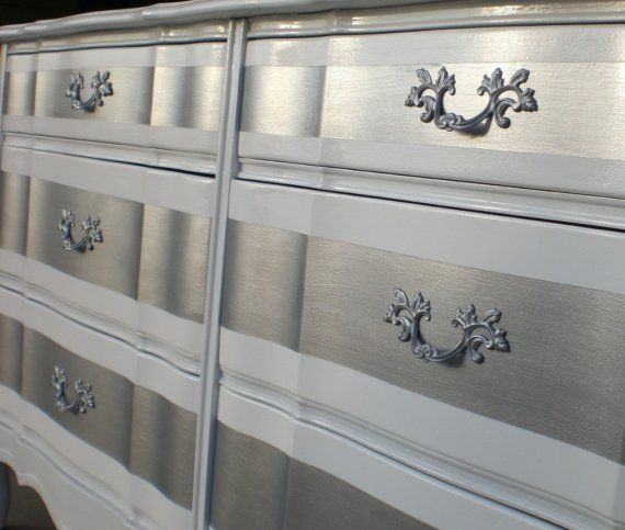 This wouldn't be hard to do with an old dresser...just paint white, tape it off, and paint silver in the accent spaces! Bijou & Boheme (the blog this came from), is wonderful for inspiration, too!