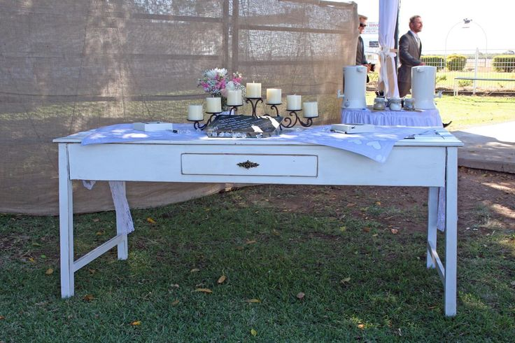 Vintage dresser used for wedding guest book.  Dressed with candle holder & flowers.