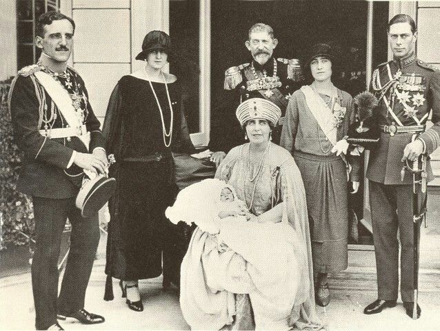 1923- Queen Marie of Romania holds her grandson Peter at his christening, her husband Ferdinand stands behind her. On the far right are the Duke and Duchess of York, the future King George VI and Queen Elizabeth of England. On the left are King of Yugoslavia and Queen of Greece.