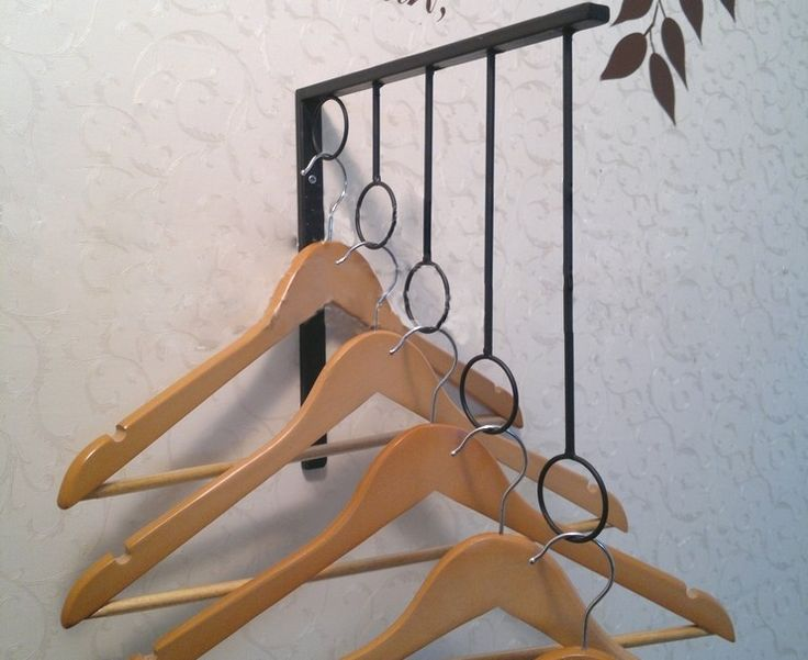 decorating ideas fascinating black metal clothes hangers with several arranged rings to keep the hangers - Clothes Wall Hanger