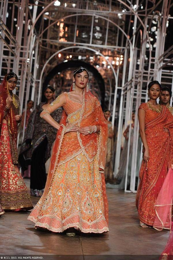 Models showcase creations by designer Tarun Tahiliani during the Grand Finale of the India Bridal Fashion Week (IBFW) 2013, held in New Delhi.