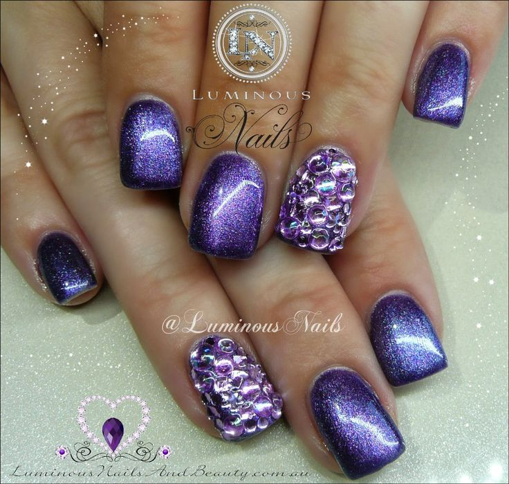 Luminous Nails: Metallic Purple Nails with Purple Crystals..