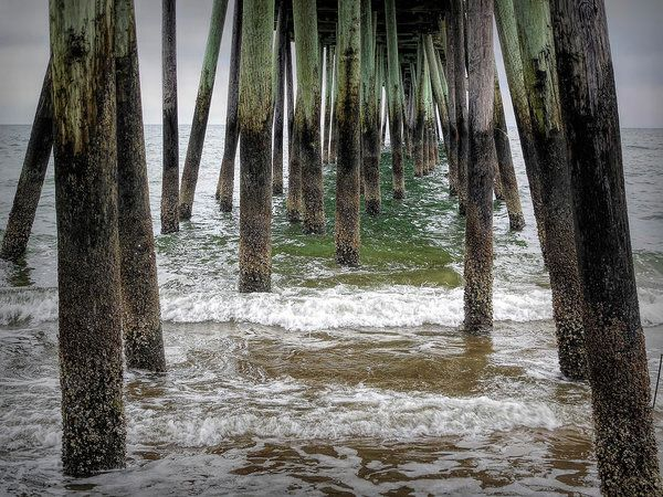 Under The Pier  Art Print by Leslie Montgomery.  All prints are professionally printed, packaged, and shipped within 3 - 4 business days. Choose from multiple sizes and hundreds of frame and mat options.