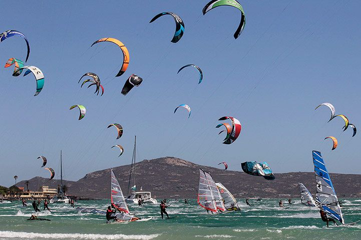 In a scene reminiscent of gulls circling above a harbour, a fleet of kitesurfers, windsurfers and Hobie Cats take part in the Downwind Dash in Langebaan, South Africa. The Downwind Dash is the biggest multi-discipline sailing regatta in Africa