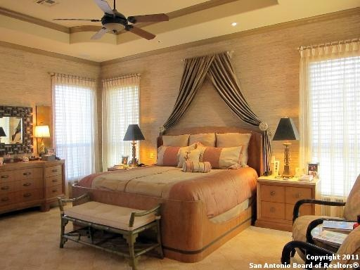 curtain rod above the bed with fabric draped over it and