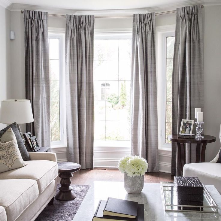"""Lovely bay window treatment.  Off center window can still work in a space.  We love framing each window with an envelope of rich fabric.  Designed by LUX…"""