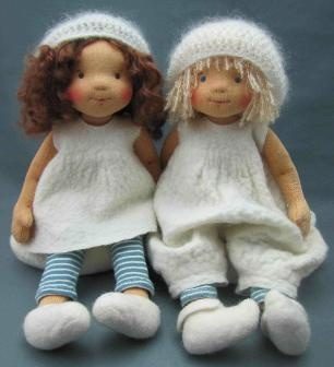 of the cutest hand-made dolls I've seen. Love their hair & faces
