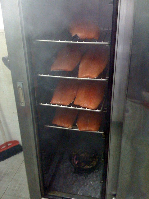 """Smoked Salmon in the making in my """"self built"""" smoke oven.  notice the skillet with smouldering apple wood in the bottom, with lots of ice cubes beneath to ensure the room doesnt warm up because of the fire, as we dont want to cook the salmon but just Like It!: Apples Wood"""