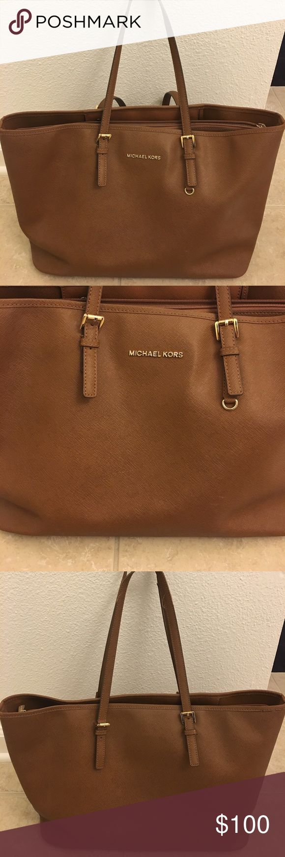 Michael Kors large luggage tote Michael Kors large luggage tote. Great for traveling for business, can fit laptop iPad and phone. Tons of compartments. Michael Kors Bags Totes