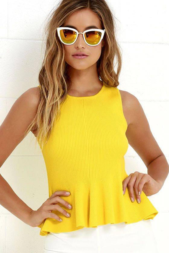 Create a look that's totally electric with the Watts Up Yellow Peplum Top! Ribbed medium-weight stretch knit, in a vibrant yellow hue, shapes this structured top with a rounded neckline, sleeveless bodice, and flaring peplum hem.