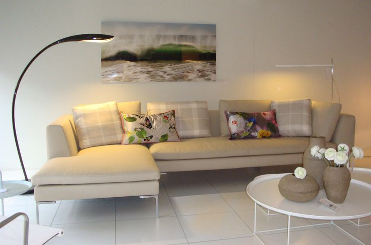 Showroom fat fat table, charles sofa, new cushions and a beautiful photo of Suzanne Liem