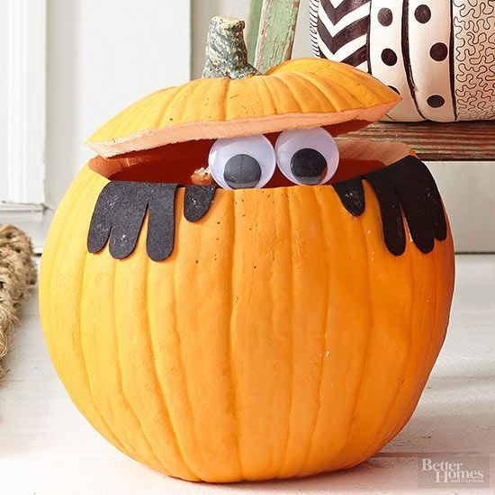 Liven up your Halloween scene with an adorable carved and embellished pumpkin.