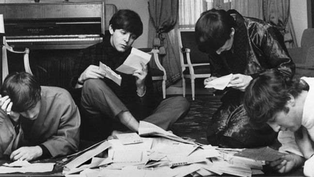 """The Beatles read their mail in 1964. """"Ringo wasn't good-looking, but who do you think got the most fan letters?"""" says Benson. """"Ringo: big pile. Then George, then John. Paul got a little teensy pile"""": The Beatles, Thebeatles, Fans, 1964, Beatles Reading, Photo, Harry Benson"""