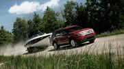 Equipped with the Class III Trailer Tow Package, the Explorer has a towing capacity of up to 5,000 pounds. The Explorer XLT shown in Ruby Red Metallic Tinted Clearcoat with 18-inch painted aluminum wheels.