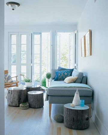 Tree stumps, used individually or clustered together, function as low tables in a living room. A coat of enamel paint applied to the tops serves a dual purpose: It adds a jolt of color and creates a smooth, sealed surface.