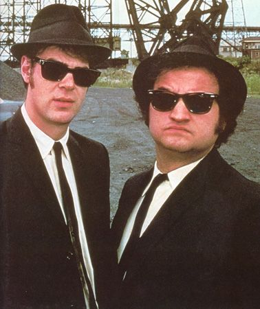 The Blues Brothers From The Blues Brothers: What to wear: White collared shirt, black suit, black sunglasses, and a fedora. Add sideburns. How to act: Jam out on a harmonica all night.