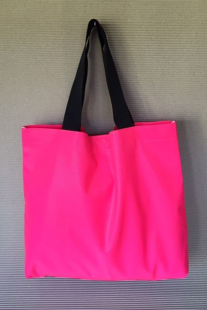 Carry everything you need in this versatile bag. Made from heavy duty cotton backed,  water resistant PVC they have wide  nylon webbing straps for strength and durability with a velcro closure at the top. Generous in size they're great to use for your grocery shopping or for a family day at the beach. Easy to wipe down with a damp cloth they're ideal for carting all of the kids gear for sports, dance classes and after school activities. Dimensions: 55cm wide, 50 cm high and 10cm deep.