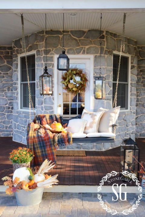 Make Use of What's Already There Tutorial: If your porch is always adorned in furniture, transform it for fall with a few quick updates. This porch swing went from a summer hangout spot to a cozy autumn retreat thanks to plush pillows and a tartan throw.