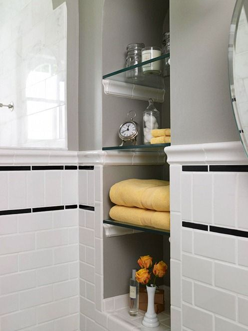 In between studs storage idea - glass shelves look really nice. They used the chair rail tile as the shelf supports - cool idea.