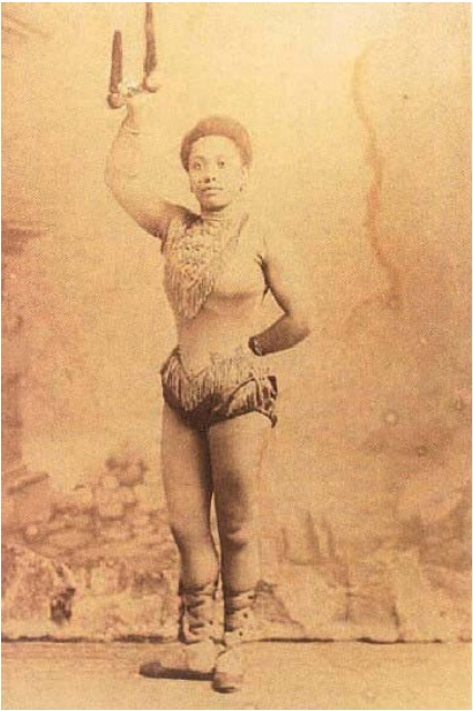 Miss Lala. Acrobat, wirewalker, trapeze artist and strongwoman. Miss La La's real name may have been Olga Kaira. She was born in 1858 in Stettin, Germany (now Poland) and began performing at the age of nine. She appeared under various stage names including 'Olga la Négresse', 'The African Princess' and 'The Cannon Woman' after a stunt in which she held up a cannon by her teeth.