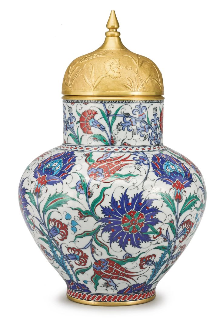 A LARGE TURKISH IZNIK-STYLE POTTERY POLYCHROME JAR AND GILT-METAL TOMBAK-STYLE COVER, MODERN in 16th-century Iznik style, black painted artist's marks in Arabic for Adnan Hodja. height overall 20 in.