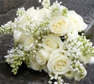 White roses, white lilac, white lily if the valley and white ranunculus. #weddings #flowers