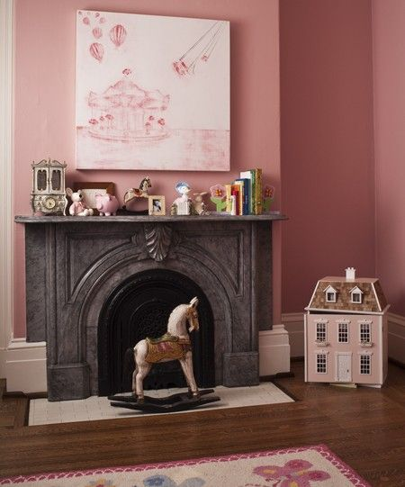 But I like the vibe. Pink Girl's Room: Grown-up architectural details add unexpected elegance to a child's bedroom. Bubblegum pink walls and artwork create a decidedly feminine look in this young girl's room. A steel grey marble fireplace provides a dramatic focal point and keeps the space from appearing overly sweet. Photographer: Ted Yarwood
