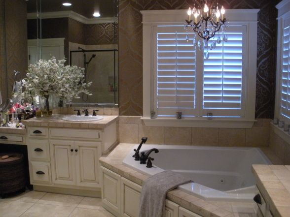 I like the corner tub but not the white cabinets change them to dark wood.