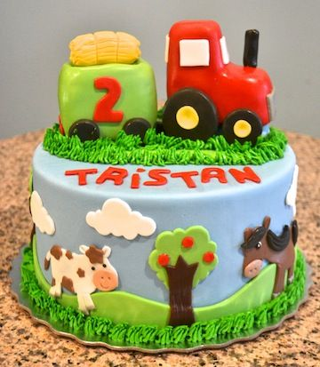 Tractor birthday cake with some adorable farm animals!
