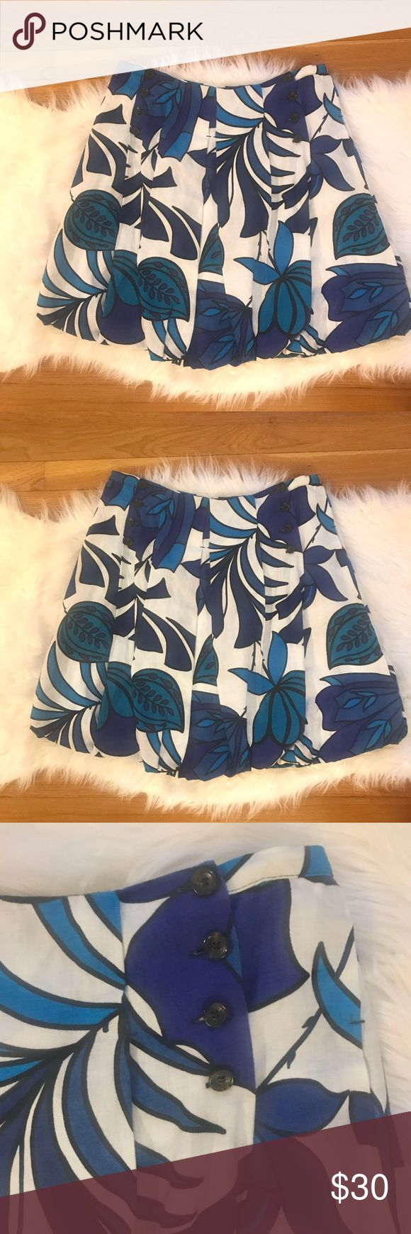 """ZARA WOMAN Bright Blue Printed Pleated Skirt L Bold graphic printed skirt with beautiful construction. 100% linen lined with 100% cotton. Made in Spain. Bright floral print in blues and black on a white background. Pleated with button detail on front. Bubble hem. Excellent pre-owned condition with no flaws or signs of wear. Great piece for spring and summer!  Approximate measurements: Waist 16"""" Length 19.5"""" Zara Skirts"""