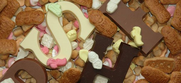 Chocolate letters, available in different tastes and decoration, normally you get the letter of the first letter of your name.